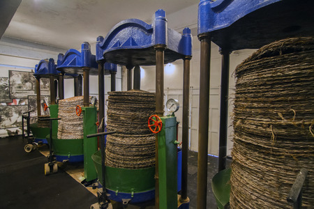oil mill: View of old pressing units for olive production. Stock Photo