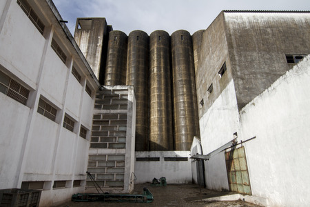 flour mill: View of an old abandoned flour mill silo structure. Stock Photo