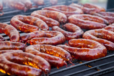 chorizos: Close up view of many portuguese chorizos on a barbecue.