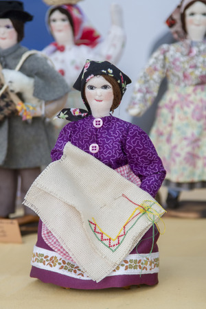 crafted: Close up view of beautiful handmade crafted folk dolls of Portuguese culture. Stock Photo