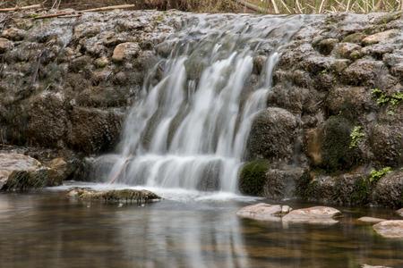 region of algarve: Beautiful view of a fresh waterfall  in the Algarve region, Portugal.