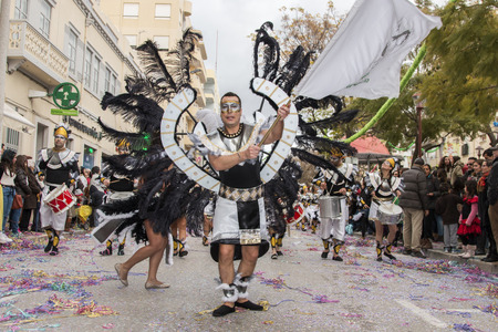 carnaval: LOULE, PORTUGAL - FEB 2015: Colorful Carnival (Carnaval) Parade festival participants on Loule city, Portugal.