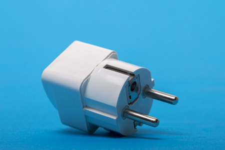 ac: Close up view of an AC electric adapter from type g (UK) to type f (Europe).