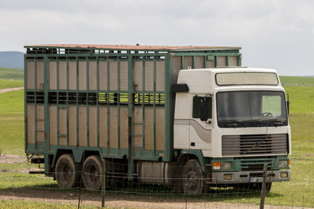 View of a animal transport truck on the countryside.