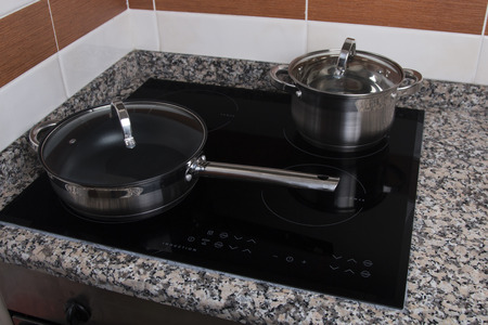 hob: Close up view of an electrical kitchen induction ceramic hob.