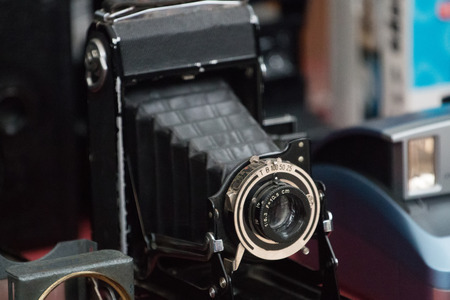 photographic camera: Close up view of a retro vintage photographic camera.
