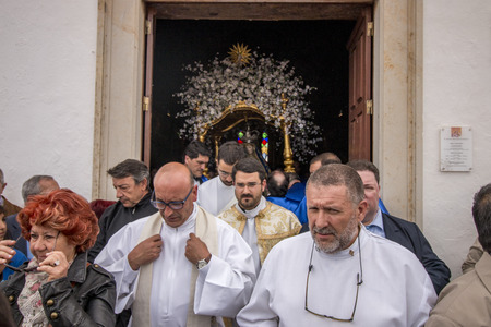 adoration: LOULE, PORTUGAL - April, 2015 : Religious celebration of the Procession of Mae Soberana in the Easter month in Loule city, Portugal. Editorial