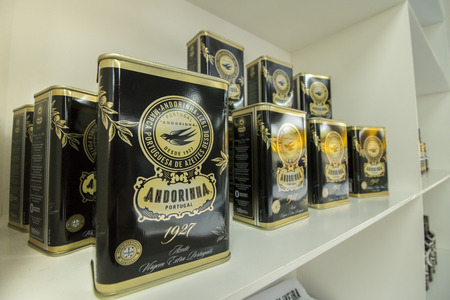 comercial: BEJA, PORTUGAL - APRIL, 2015 - Andorinha olive oil product bottles on a shelf.