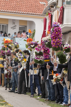 religious event: SAO BRAS DE ALPORTEL, PORTUGAL - April, 2015: Traditional religious procession of the flower torches event located in village of Sao Bras de Alportel, Portugal.