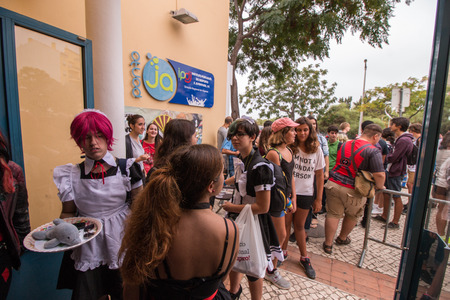 gamers: FARO, PORTUGAL - August 22: Manga & Comic Event, gathers many fans of these genres, including anime shows, cosplayers, gamers, concerts, board games, workshops and contests, among several other stuff held on Faro city, Portugal on August 22nd and 23rd, 20 Editorial
