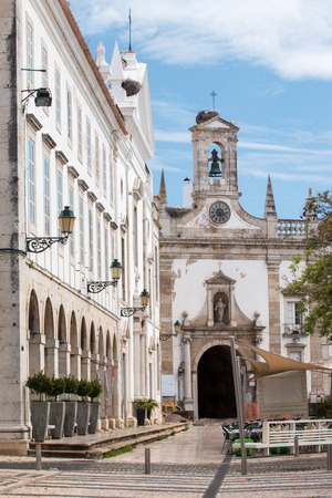 manuel: View of the arcs and main entrance to the old town in the garden Manuel Bivar, located in Faro, Portugal. Stock Photo