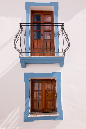 iron curtains: Close view of a typical window from the cubist town of Olhao, Portugal.