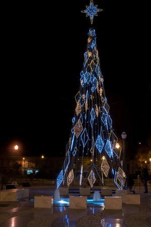 fake christmas tree: Wide view of the Tavira city square by night in christmas located in Portugal. Stock Photo