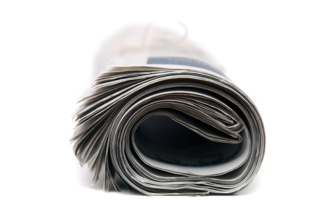 object printing: Close view of a rolled up newspaper with string isolated on a white background.
