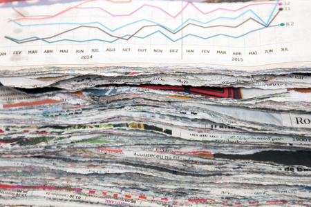 pile of newspapers: Close view of a slice (cut) pile of used newspapers.