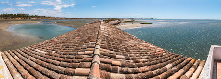 formosa: View of traditional rooftops of the Algarve region next to Ria Formosa marshlands, Portugal. Stock Photo