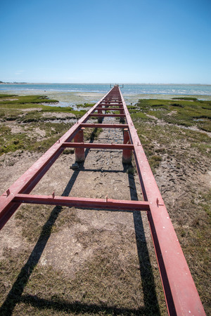 ria: Unfinished bridge on the marshlands of Ria Formosa, Portugal.