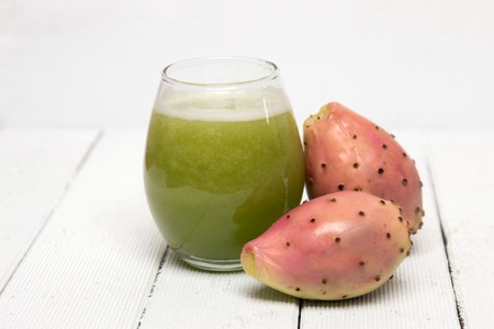 drinkable: View of drinkable juice made from opuntia ficus-indica cactus fruits on a white background