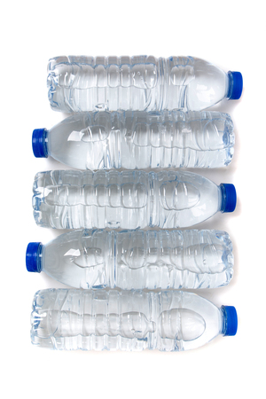 water bottles: Top view of a row of plastic water bottles isolated on a white background.