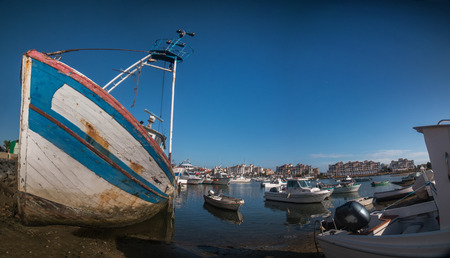 moral: Traditional fishing boats on the shore in Isla del Moral, Spain