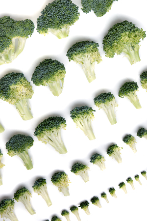 aligned: Close view of a bunch of broccoli vegetables aligned in a perfect way. Stock Photo