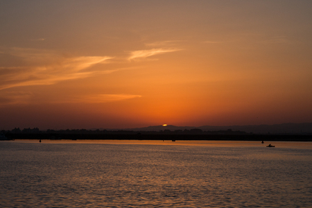 isla: Sun disappears on the horizon in Isla del Moral, Spain.