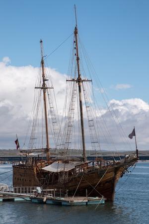 caravel: Vintage restored Caravel ship anchored in the docks of Portimao city, Portugal Stock Photo