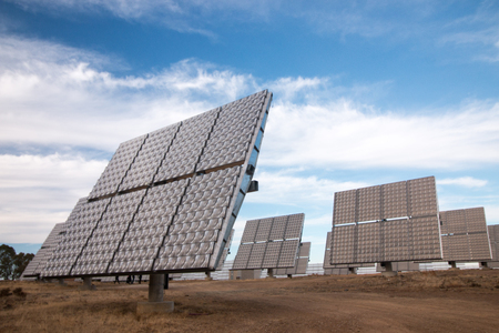 rotative: View of a field of photovoltaic solar panels gathering energy on the countryside. Stock Photo