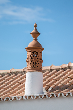 typical: Typical Portuguese chimney design architecture from the Algarve region.