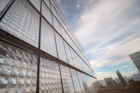 rotative: Upward close view of a photovoltaic solar panel gathering energy.