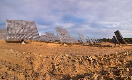 rotative: Rotative photovoltaic solar panels park on dry land.