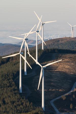 windy energy: Eolic wind generators on top of hills in Portugal.