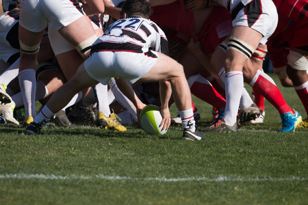 dispute: Rugby players grab each other in a dispute for the ball.