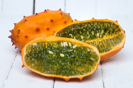 hedged: Close up view of the horned melon fruit on a white background.