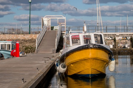View of the olhao city docks with traditional fishing boats.