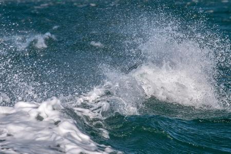 waves crashing: Close view of ocean waves crashing each other.