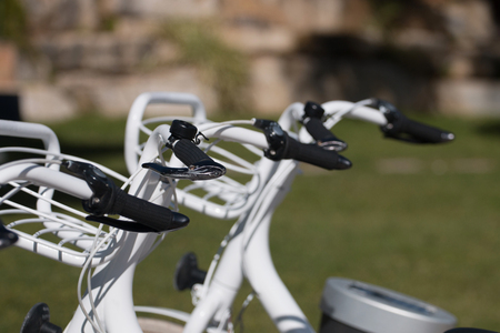nice looking: Nice looking white bicycles parked on the city for rental.