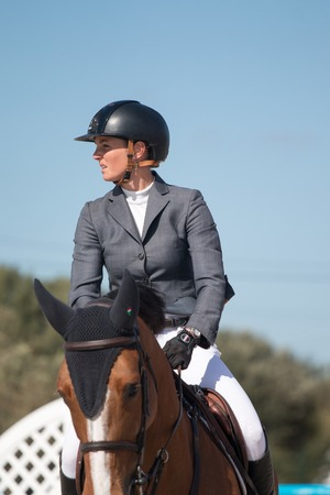 equine: VILAMOURA, PORTUGAL - APRIL 2, 2016: Horse obstacle jumping competiion, called Vilamoura Atlantic Tour that brings the finest athletes to the event.