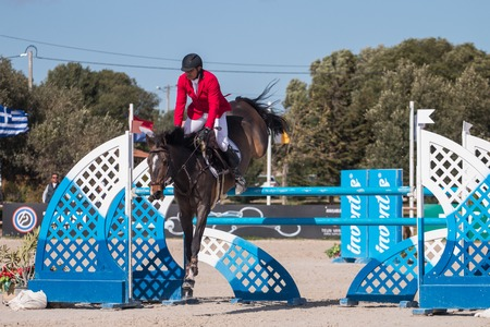 VILAMOURA, PORTUGAL - APRIL 2, 2016: Horse obstacle jumping competiion, called Vilamoura Atlantic Tour that brings the finest athletes to the event.