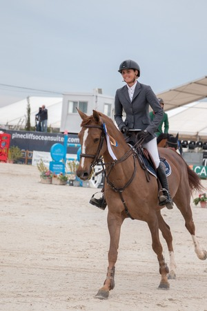 VILAMOURA, PORTUGAL - APRIL 3, 2016: Horse obstacle jumping competiion, called Vilamoura Atlantic Tour that brings the finest athletes to the event.