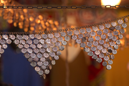 Close up view of a hip belt for a female belly dancer.