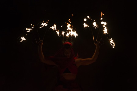 pyro: CASTRO MARIM, PORTUGAL - AUGUST 28, 2016: View of people, characters, mood, colors and street performers at the popular medieval fair held in Castro Marim village, Portugal. Editorial