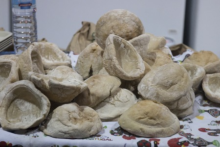 concave: Close view of special Portuguese bread, cooked in a concave shape.