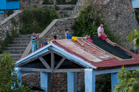CHEFCHAOUEN, MOROCCO - SEP 10, 2016: Community laundry location view in Chefchaouen blue city, Morocco