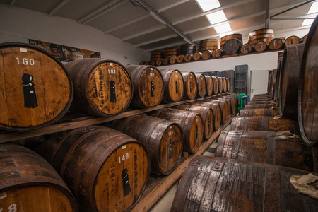 capote: SAO MIGUEL ISLAND, AZORES, PORTUGAL - MAY 24, 2016: Storage of barrels of the Mulher do Capote liquor factory located in Sao Miguel island, Azores, Portugal.
