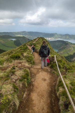 crater lake: Tourists visit Canario viewpoint in Sao Miguel island, Azores, Portugal.