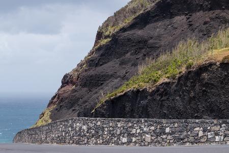 Landscape view of volcanic Ponta da Ferraria coastline in Azores, Portugal.