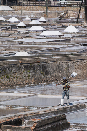 sediments: RIO MAIOR, PORTUGAL - July 20th, 2016 : View of a worker walking between the salt ponds in Rio Maior.