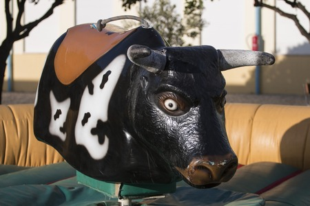 View of a mechanical bull machine with nobody.