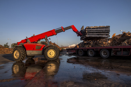 maneuvering: View of a vehicle maneuvering raw cork planks from heavy duty truck. Stock Photo